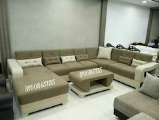 grey fabric tufted sectional sofa with throw pillows