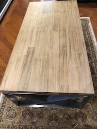 New Rustique wood coffee table with metal frame see pictures size LxWxH 47x23.5x16 contact Richard  [PHONE NUMBER HIDDEN]  Toronto, M9V 4T4
