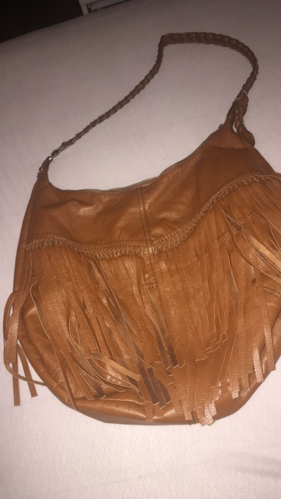 brunt skinn fringed hobo bag