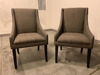 Two brown wooden framed gray padded chairs Las Vegas, 89147