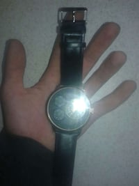 round silver chronograph watch with black leather strap Moncton, E1H
