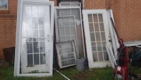 white-and-brown wooden framed glass doors and windows New Orleans, 70127