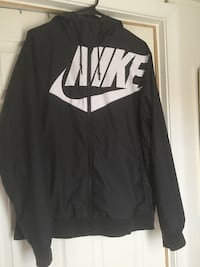 black and white Nike zip-up jacket 47 km