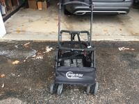 black and gray Craftsman push mower 556 km