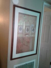 white and brown wooden framed painting Modesto