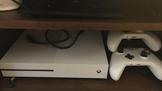 White xbox one console and controller