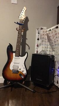 brown and white stratocaster electric guitar Calgary, T1Y 5A9