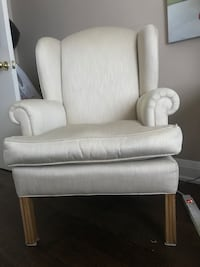 Beige wingback chairs