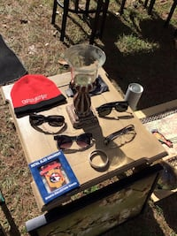 three sunglasses; one eyeglases; red knit cap Tallahassee, 32303