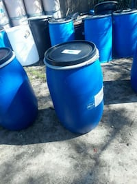 two blue and black plastic barrels Patchogue, 11772