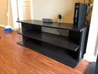 black wooden TV stand with mount 21 km
