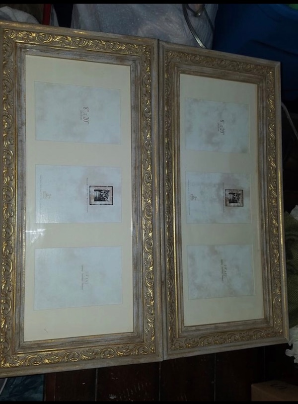 Two rectangular brass-colored photo frames