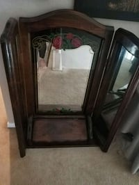 Mirror with attached jewelry box
