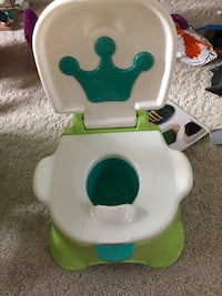 white and green Fisher-Price potty trainer 47 km