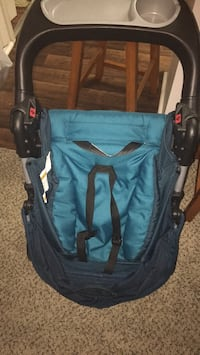 Blue and black Costco Stroller null