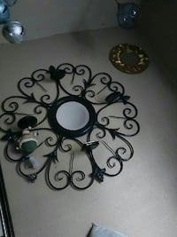 round black floral wall candle holder
