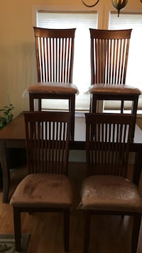 Four brown wooden armless chairs and table Anchorage, 99517