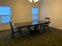 Dark brown formal dining room table with 2 chairs. Never used.  Waldorf, 20601