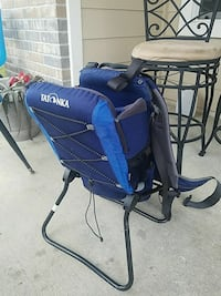 blue and black baby carrier and chair Houston, 77090