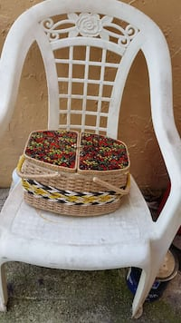 brown, white, black, yellow, and red floral wicker picnic basket