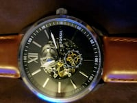 round silver chronograph watch with brown leather strap 403 mi