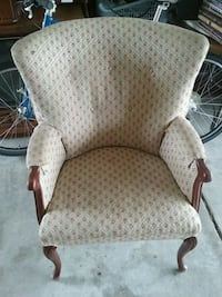 brown wooden framed white padded armchair 487 mi