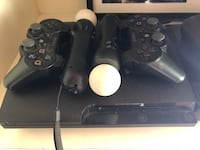 black Sony PS3 console with 2 DualShock wireless controllers, 2 move motion controllers, and eye camera Grant-Valkaria, 32950