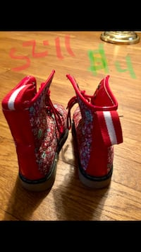 pair of red-and-white floral lace-up boots Lynchburg