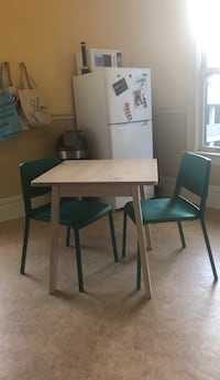 Brand new ikea table with two brand new chairs