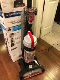 Black and red bissell upright vacuum cleaner