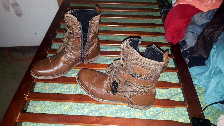 pair of brown leather military boots - Midway
