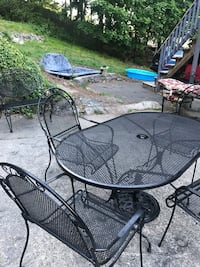 Wrought iron patio set with matching bench and cast iron stand