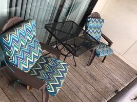 Patio chairs with cushions and table