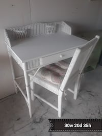 white wicker single-drawer table
