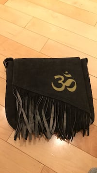 Brand new om yoga shoulder bag, I have 2, one gray, one black. Never used. Lovely to carry. Hope some one can use it. Real leather.