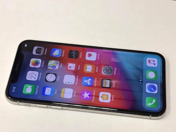 Unlocked IPhone X 256gb Silver  Works With Any Sim  Att, T-Mobile, metro  pcs, cricket, and Overseas  Comes with charger and cable  In excellent