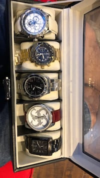 Four round silver-colored analog watches