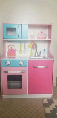 pink and white wooden kitchen cabinet Arlington, 22201