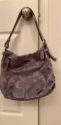 coach pocketbook purple good condition smoke free and pet free