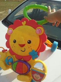 baby's yellow and red Fisher-Price musical lion walker