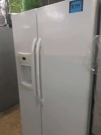GE side by side refrigerator excellent condition  Baltimore, 21223