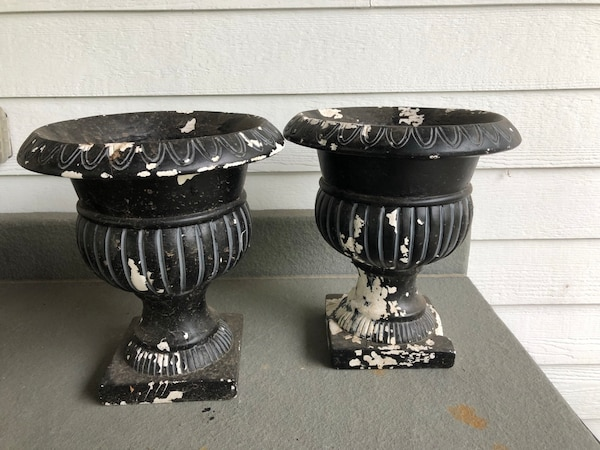 two black-and-gray candle holders