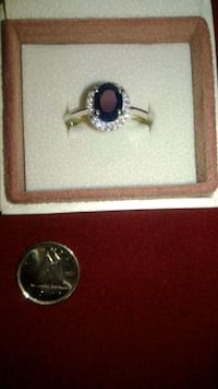 Sterling silver ring with 1 karat Sapphire precious center stone