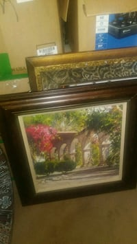 brown wooden framed painting of house 2271 mi
