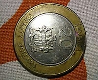 round silver-colored and gold-colored 2-tone 20 dollars coin
