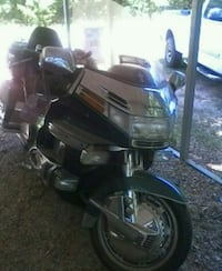 black and gray touring motorcycle Humble, 77346