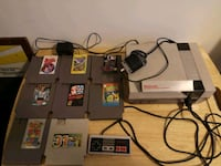 black NES console with controllers and game cartridges Montréal, H4B 1Y8