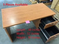 brown wooden single pedestal desk with text overlay VANCOUVER