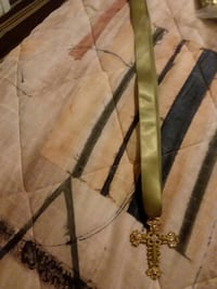 Green and gold tone cross necklace