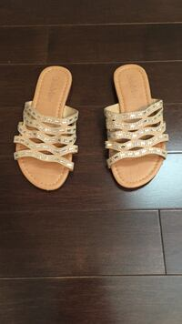 women's pair of beige studded sandals